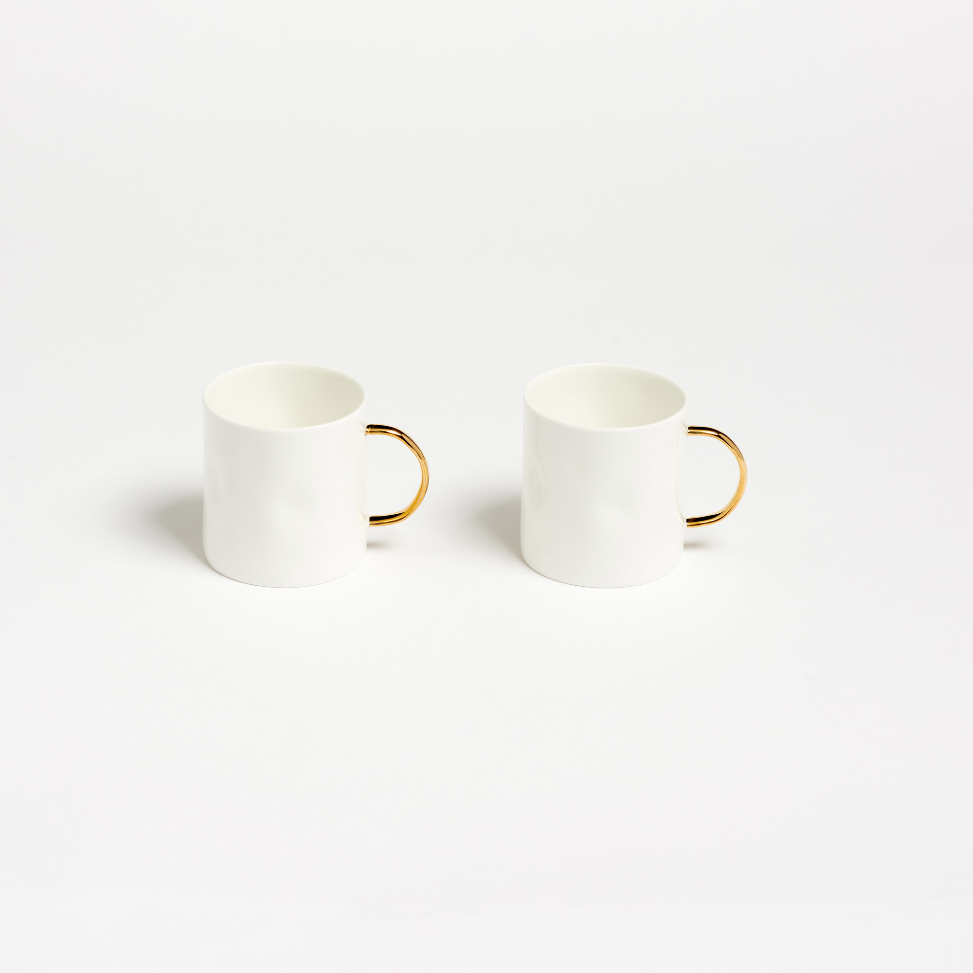 Feldspar Pair of Gold Handled Coffee Mugs The…