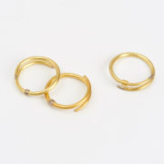 Stack of Crossover Rings in Yellow, Red and White Gold (Sold Separately) - Jean Scott Moncrieff Crossover Rings Rose Gold Silver 1 The Garnered