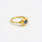 Handmade Gold Ring with Oval Brilliant-Cut Sapphire - Jean Scott Moncrieff Gold Ring Sapphire Side The Garnered