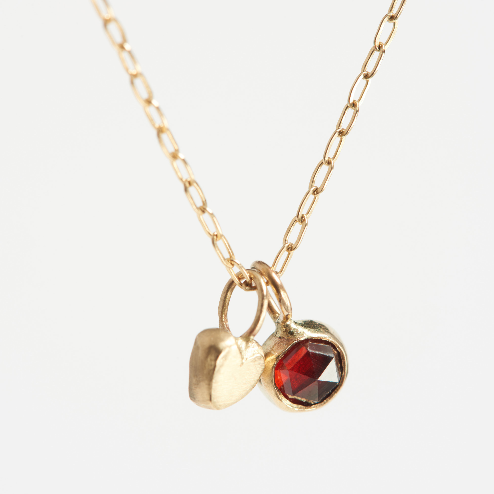 14k Gold Heart And Garnet Limited Edition Charm Necklace
